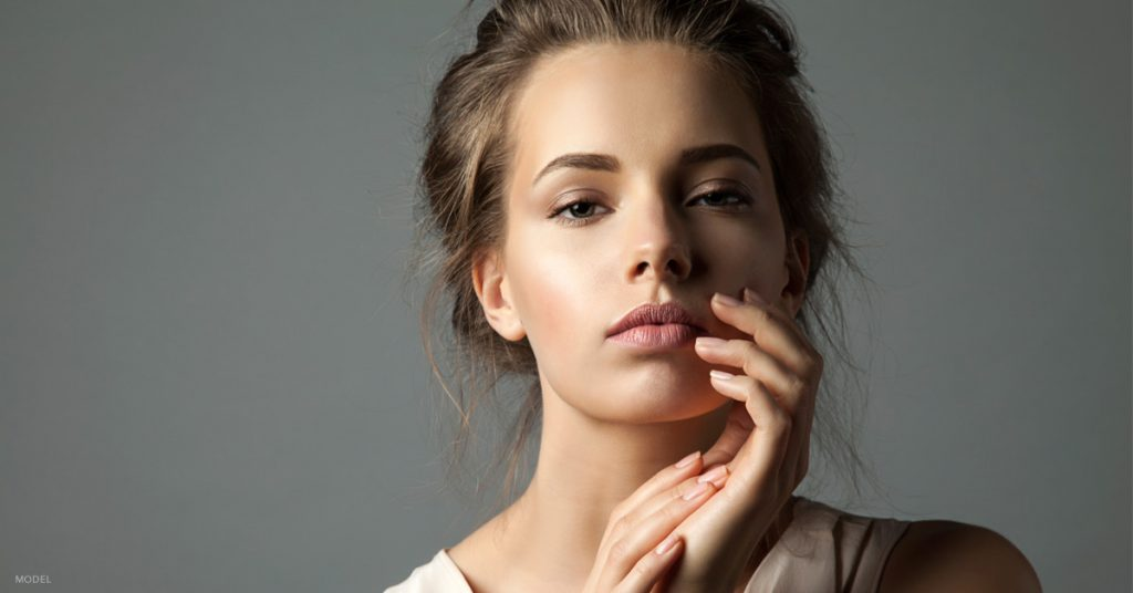 Young woman after a nonsurgical nose job with dermal fillers