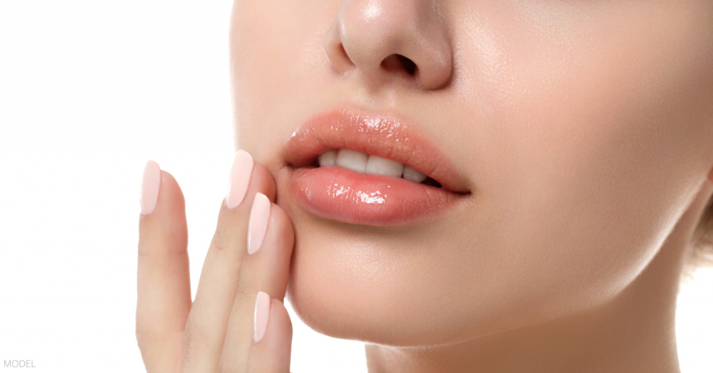 A woman happy about getting lip fillers with JUVÉDERM.